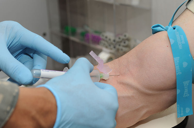 File:Patient gets blood drawn to be screened as a blood donor.jpg
