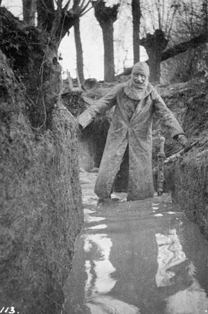 Philip Robertson (British Army officer) - Colonel Philip R Robertson, commanding officer of the 1st Battalion, Cameronians (Scottish Rifles) returning from a tour of his unit's positions in waterlogged trenches at Bois Grenier in January 1915.