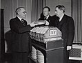 "Photograph of First Archivist of the United States R. D. W. Connor Receiving Film ""Gone With The Wind"" from Senator George of Georgia and Loew's Eastern Division Manager Carter Barron, 1941 (13586864495).jpg"