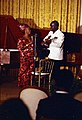 Photograph of President Kenneth Kaunda of Zambia Playing the Guitar While Betty Kaunda Sings during an Impromptu Performance in the East Room during the Entertainment Portion of a State Dinner Honoring the Preside(...) - NARA - 7518557.jpg