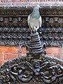 Pigeon Poses on Wooden Spire - Kumari Bahal - Durbar Square - Kathmandu - Nepal (13443866934).jpg