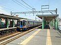 Platform of Shirakibaru Station and express train bounding for Nishitetsu-Ogori Station.jpg