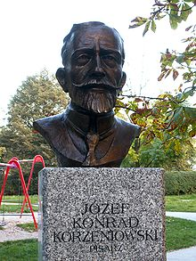 "Statue of Joseph Conrad with inscription ""Jozef Konrad Korzeniowski"""