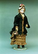 Porcelain doll in period dress. France, 1877.jpg