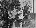 Portrait of woman holding baby (AM 79628-1).jpg