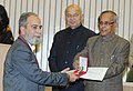 Pranab Mukherjee presenting the medal to Shri Farooq Ahmed (Jammu & Kashmir), at the Medal Ceremony organized by the Office of the Registrar General & Census Commissioner, India, in New Delhi. The Union Home Minister.jpg