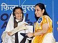 Pratibha Devisingh Patil presenting the Indira Gandhi Award to Ms. Neeta Jadhav for the Best Debut Film of a Director (Baboo Band Baaja), at the 58th National Film Awards function, in New Delhi on September 09, 2011.jpg