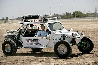 Dune buggy - George W. Bush riding US Border Patrol dune buggy
