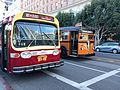 Preserved Muni GM bus 3182 and White bus 042 on Steuart St (2016).jpg