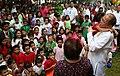 President Benigno S. Aquino III carries a child during the Pasko ng Batang Pinoy 2014 at the Kalayaan Grounds of the Malacañan Palace.jpg