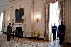 "William G. Allman - President Barack Obama and First Lady Michelle Obama tour the State Dining Room with White House Chief Usher Admiral Stephen ""Steve"" Rochon (left), White House Curator William G. Allman (second from right), and presidential personal aide Reggie Love (far right) on January 24, 2009."