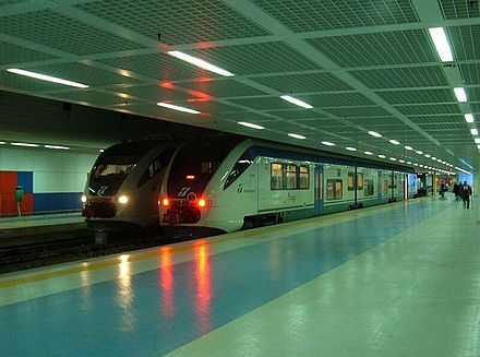 Two trains inside Punta Raisi railway station within Palermo International Airport Punta Raisi staz ferr treni.jpg