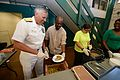 Rear Adm. Mike Smith serves meals to the homeless. (14853808475).jpg