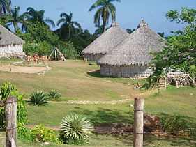 According to descriptions that survive, the homes of the prehistoric inhabitants of the city may have looked very similar to these Taino culture huts in Baconao Reconstruction of Taino village, Cuba.JPG