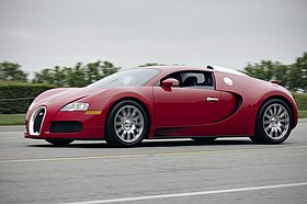Red Bugatti Veyron on the road (7559997596).jpg