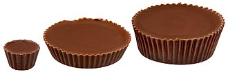 Reese's Peanut Butter Cups - A trio of different sized cups. Starting from the left: mini, regular and big cup.