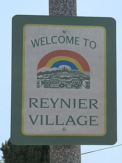 """Welcome to Reynier Village"" sign located at the intersection of Cadillac & Shenandoah."