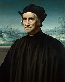 Portrait of Benivieni as an old man wearing a black cassock and hat seated in front of a snowy landscape painting.