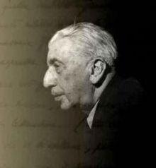 Photo en noir et blanc du profil gauche d'un homme aux cheveux blancs.