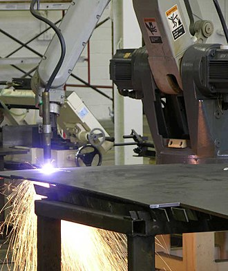 Plasma cutting - Plasma cutting performed by an industrial robot