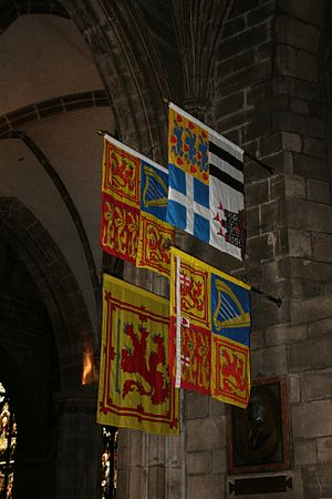 Royal Standard of the United Kingdom - Royal Banners in St Giles' Cathedral: The Royal Standard of the United Kingdom used in Scotland and (clockwise) those of the Duke of Edinburgh, Princess Royal and Duke of Rothesay.
