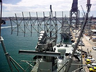 AN/SPS-49 - Antenna of an AN/SPS-49(V)8 ANZ radar system on a Royal Australian Navy ANZAC class frigate. The AS-177B/UPX antenna fitted to the rear of the reflector functions as a back-fill radiator for the AS-4328/U IFF interrogator antenna.