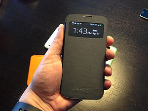 "Samsung Galaxy S4 - The ""S-View Cover"" accessory contains a window that can be used to display notifications and a clock"