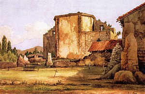 "Mission San Juan Capistrano - Misión San Juan de Capistrano by Henry Chapman Ford, 1880. The work depicts the rear of the ruined ""Great Stone Church"" as well as part of the mission's campo santo. A portion of ""Serra's Church"" is also visible at right. Oil on canvas."