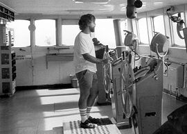 Able seamen generally serve as a ship's helmsmen, relying on visual references, compasses, and a rudder angle indicator to steer a steady course as directed by the mate or other officer on the bridge.