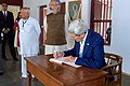 Secretary Kerry signs guest book during visit to Sabarmati Ashram.jpg