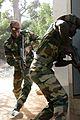 Senegalese soldiers storm building.jpg