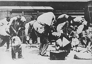 World War II persecution of Serbs - Serbs, expelled from their homes in the Independent State of Croatia, march out of town carrying large bundles.