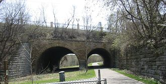 History of the Irish in Saint Paul - The Seventh Street Improvement Arches separated Swede Hollow from Connemara Patch. The north side (foreground) of the photograph is Swede Hollow; the area partially visible beyond the arches is the former site of Connemara Patch.