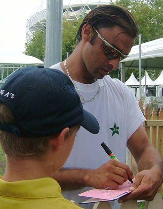 Shoaib Akhtar - Shoaib Akhtar signing an autograph in England.