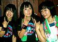 Shonen Knife posing for photos after a concert.jpg