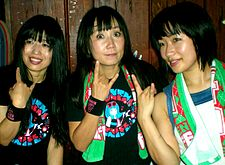 Shonen Knife posing for photos after a concert.jpg
