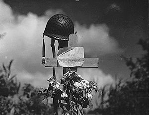 Carentan - French civilians erected this silent tribute to an American soldier who fell in the effort to liberate France from Nazi occupation, June 17, 1944