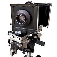 Large, boxy camera with bellows