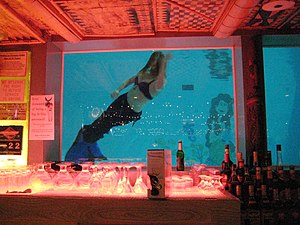 Tiki bar - People dressed up as mermaids swim at the Sip 'n Dip tiki bar in Great Falls, Montana