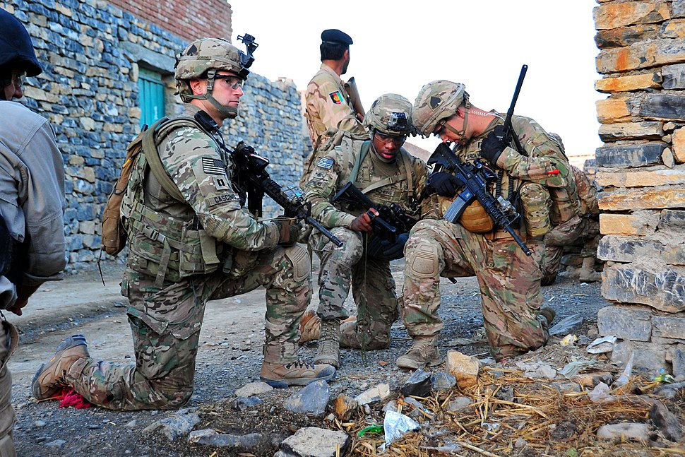 Soldiers assigned to E Company, 2nd Battalion, 506th Infantry Regiment, 4th Brigade Combat Team, 101st Airborne Division (Air Assault), conducts a partnered patrol in Madi Khel, Khowst Province, Afghanistan, Oct. 20, 2013