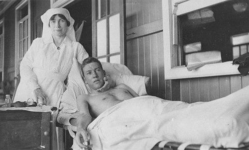 StateLibQld 1 296375 Nurse beside patient, ca. 1920.jpg