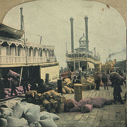 Steamboats bound for inland Alabama and Mississippi being loaded at Mobile's dockyards Steamer loading cotton in Mobile.jpg