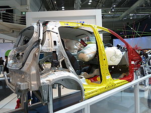 Body in white - Body in white, partially outfitted to highlight the safety systems fitted to the vehicle.