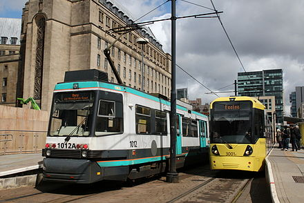 Brand transition: AnsaldoBreda T-68 & Bombardier M5000 trams in old and new livery in 2011 T68 and M5000.JPG