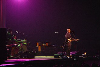 T Bone Burnett on stage at Birmingham's NIA, May 5, 2008, with Alison Krauss and Robert Plant TBoneBurnettNIA2008.JPG