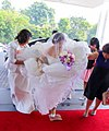 Taiwanese brides crushing a tile with her feet.jpg