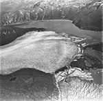 Taku and Norris Glacier, terminus of tidewater glacier in the center, and terminus of valley glacier in the foreground with a (GLACIERS 6246).jpg