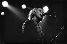 Tanya Donelly singing in a microphone