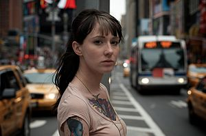 English: A tattooed girl on Times Square