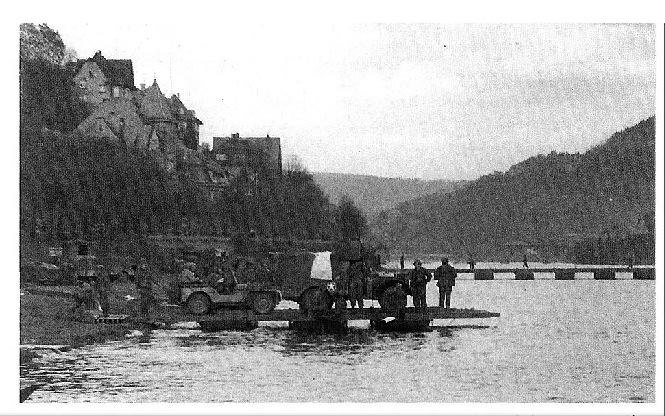 The 289th Engineer Combat Battalion ferrying troops and vehicles over the Neckar River at Heidelberg